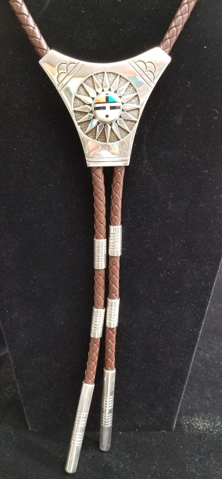 Navajo Sunface bolo tie by Henry Yazzie